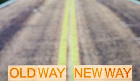 old way new way. wooden blocks with the inscription old way new way on the background of road stripes. choice concept