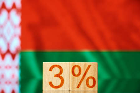 3% belarus. wooden blocks with the inscription 3% on the background of the flag of Belarus. the concept of revolution in Belarus