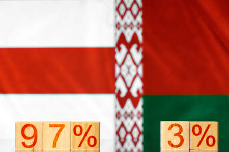 97% 3% belarus. wooden blocks with the inscription 97% and 3% against the background of two flags of belarus. the concept of protests in Belarus
