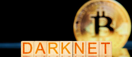 darknet. wooden blocks with the inscription darknet on bitcoin background Banco de Imagens