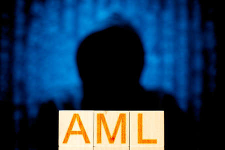aml. wooden cubes with the inscription aml on a background with a man without a face