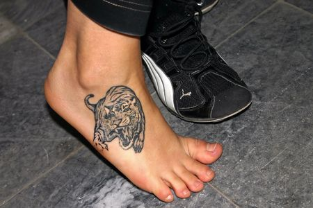Tattoo on foot Stock Photo