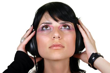 Beautiful brunette girl listening music, isolated on white Stock Photo - 2239750