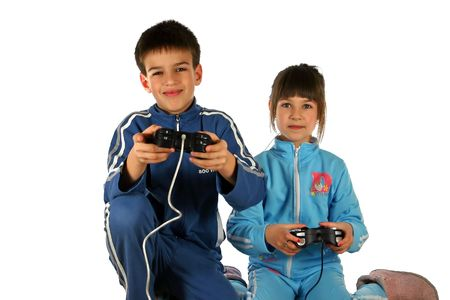 Young boy and girl enjoying a computer game, isolated on white background Stock Photo