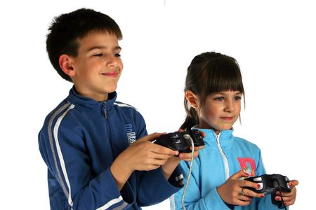 Young boy and girl enjoying a computer game, isolated on white background photo