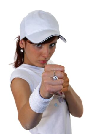 Portrait of an attractive young female punching photo