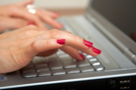 Busy business woman doing some computer work photo