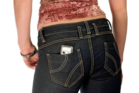 silver mobile phone in jeans pocket  photo