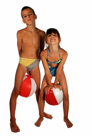 swimming trunks: Children in swimsuit with big ball, isolated on white
