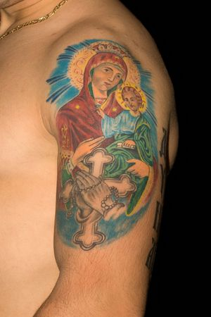 Tattoo on her shoulder man who is in front of black background