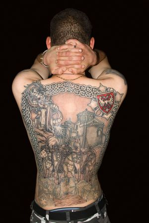 Tattoo on a back of the man photo