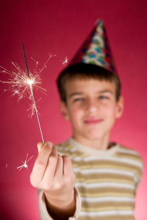 Child watching a cool firework, sparklers photo