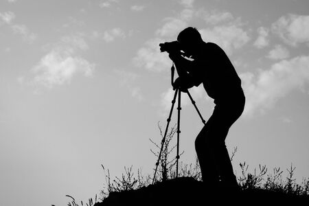 silhouette of the photographer in action photo