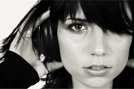 Beautiful brunette girl listening music, black and white photo