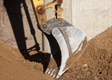backhoe: Excavator digging a deep trench