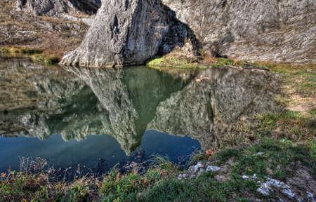 beautifu: The lake below the mountain in autumn colors Stock Photo
