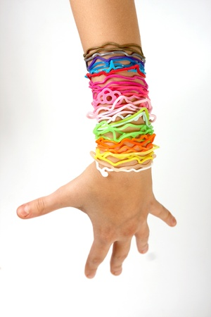 rubberband: Colorful rubber bands on his arm girls, isolated on white background