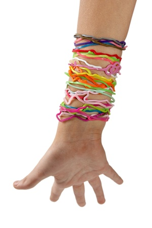rubberband: Colorful rubber bands on his arm, isolated on white background