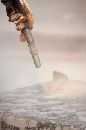 sandblasting: Sandblasting of metal structures at construction site