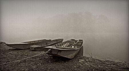 river bank: boat on the bank of river in the fog