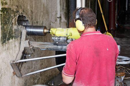 Concrete core drilling machine on a building construction site Standard-Bild