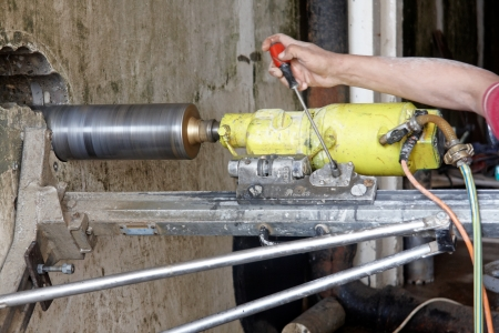 electric drill: Drilling holes in concrete Stock Photo