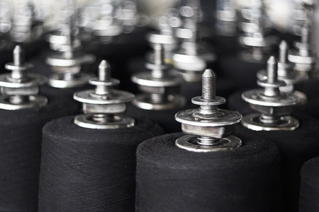 polyester: Colorful spools of thread in a textile factory Stock Photo