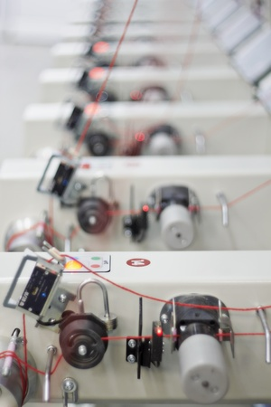 factory line: Detail of an indoor industrial production line, in a textile factory Stock Photo
