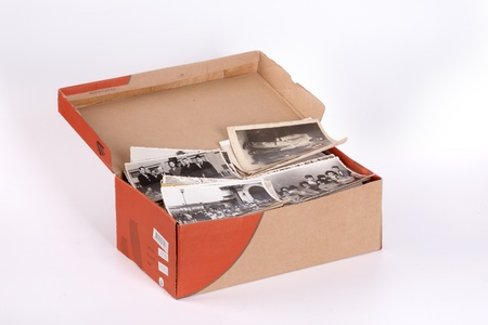 A full box of old photos, clipping path, focus on front