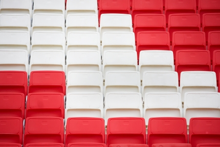 New red and white chairs in the stadium Stock Photo