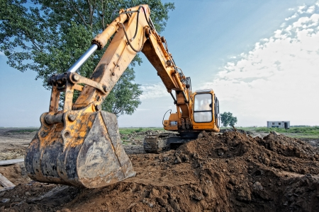 trench: excavator digging a trench for the pipeline Stock Photo