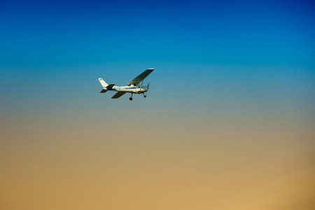 turboprop: Small turboprop plane against a blue sky