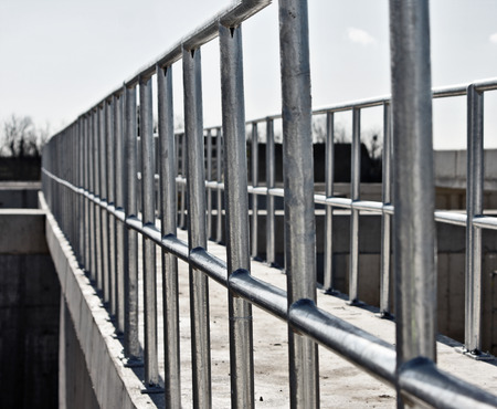 metal handrail: New galvanized fence at an industrial plant