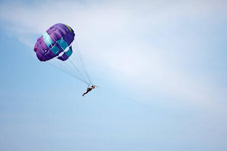 parasailing: Parachuting at sea, Parasailing with a boat over the sea  Stock Photo
