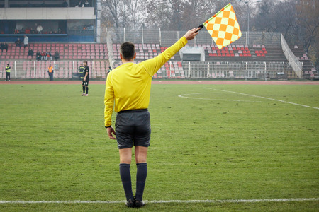 judge players: Assistant football referee, soccer referee in the stadium Stock Photo