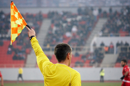 Assistant football referee, soccer referee in the stadium Stock Photo