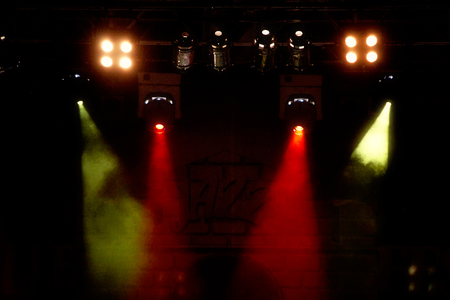 lighting effects musician: colorful concert lighting on a dark background