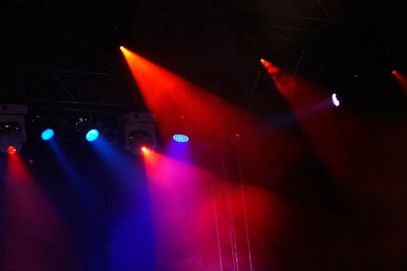 lighting effects musician: Image of colorful concert lighting on a dark background