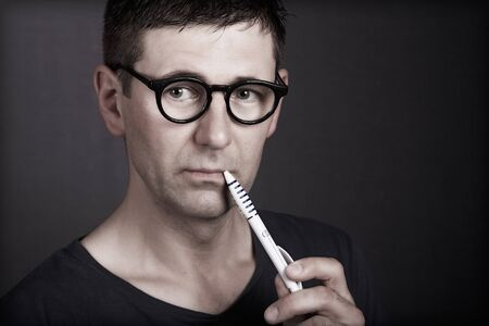 low glass: Portrait of young men with glasses while thinking Stock Photo