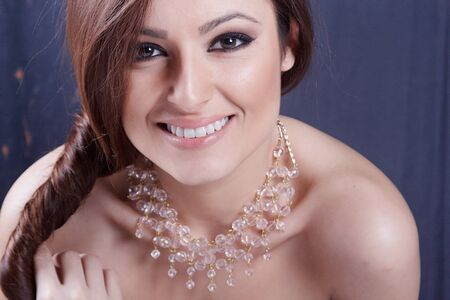 Beautiful young girl wearing a necklace