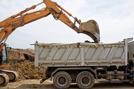 construction vehicle: Excavator loader machine during earthmoving works outdoors at construction site Stock Photo