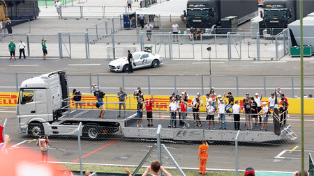 drivers: Hungaroring, Hungary - July 27: Formula One drivers standing on the back of a lorry wave at the public during the F-1 Drivers parade, prior to Hungarys Formula one GP.  July 25-27. 2014. Budapest, Hungary
