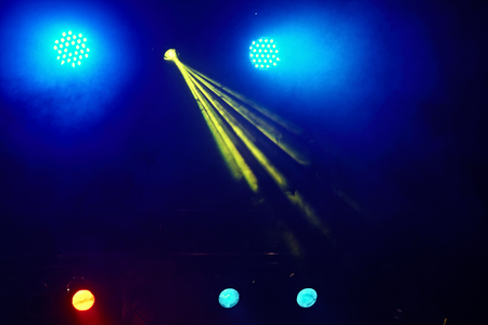 lighting background: Concert light show. Image of colorful concert lighting against a dark background Stock Photo