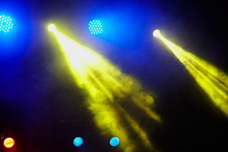 concert background: Concert light show. Image of colorful concert lighting against a dark background Stock Photo