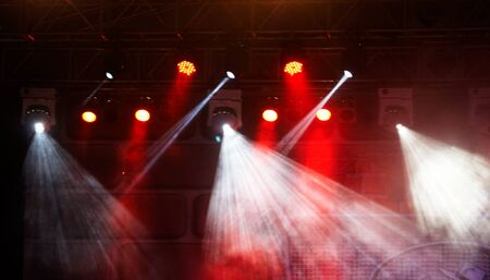 fiestas discoteca: concert light show, colorful and vivid stage spotlight on stage background