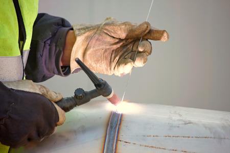 welder: Welding in protective atmosphere of gases, TIG - Tungsten Inert Gas Welding Stock Photo