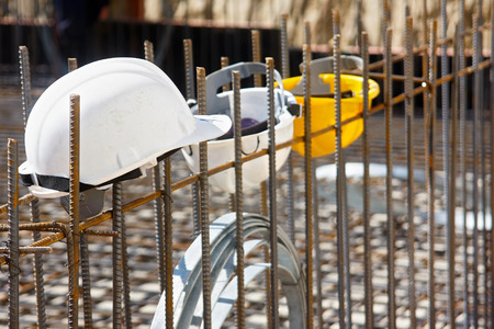 reinforcement: Workers helmets hooked to steel reinforcement. The focus forward Stock Photo