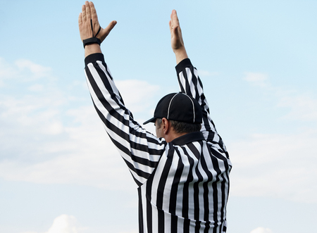 The back of an American football referee, clipping path