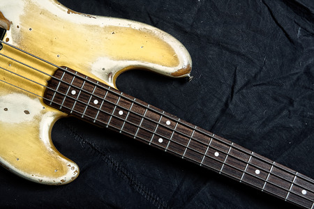 fingerboard: Closeup of old electrical bass guitar fingerboard