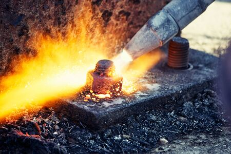 Cutting metal with propane, oxygen, acetylene torch, burner equipment Stock Photo
